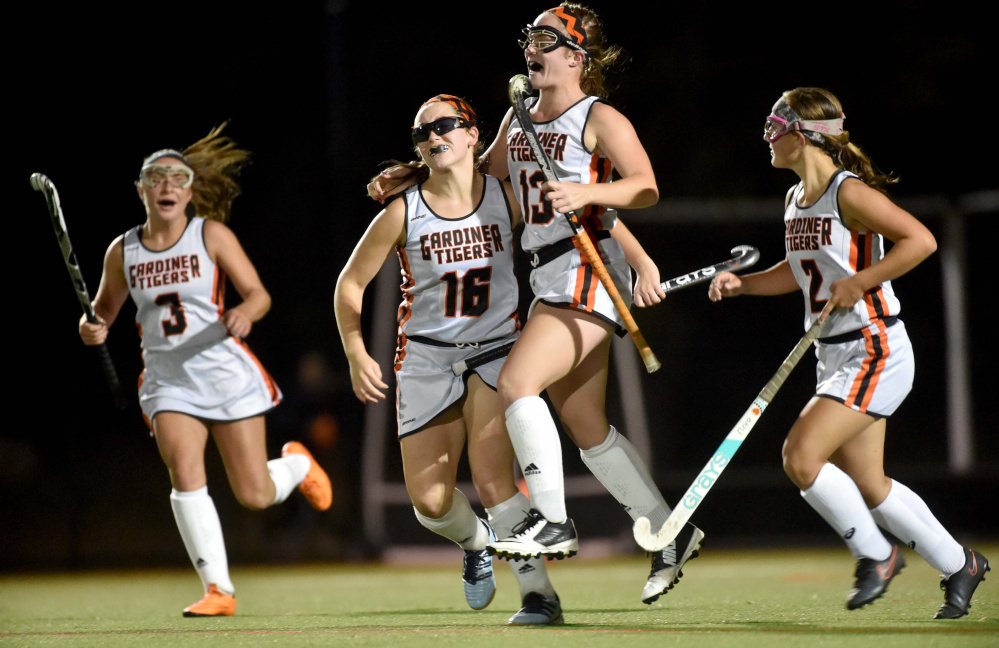 Gardiner's Hailee Lovely (13) celebrates her goal against Winslow with teammates Jillian Bisson (16), Madelin Walker (3) and Haley Brann, right, Tuesday at Thomas College in Waterville.