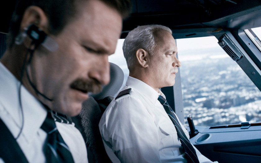 """Aaron Eckhart, left, as Jeff Skiles and Tom Hanks as Chesley """"Sully"""" Sullenberger in """"Sully."""""""