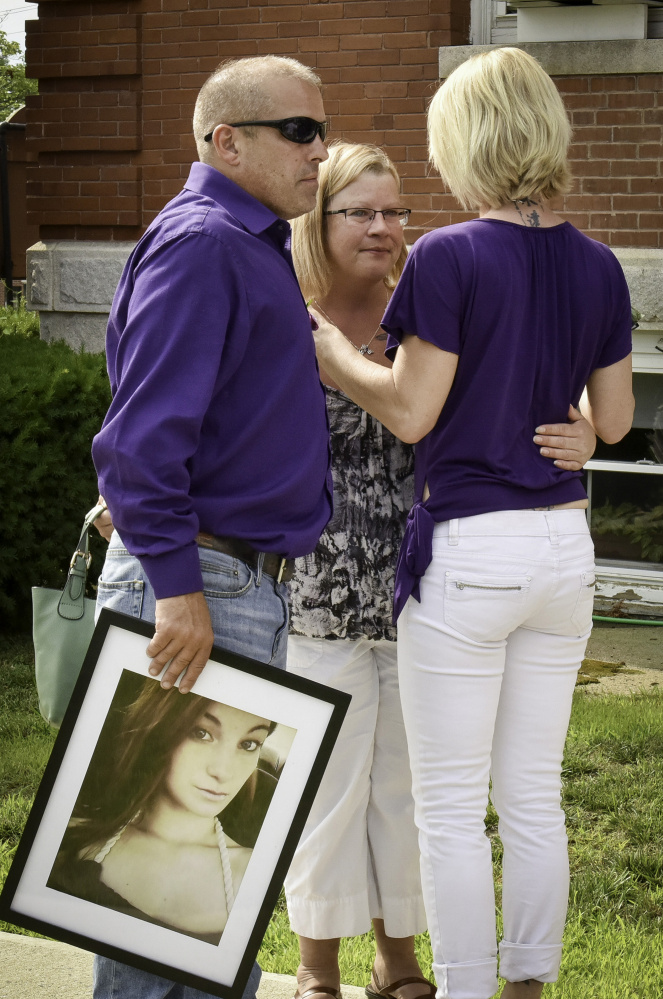 A friend embraces Taylor Gaboury's parents, Tena Trask and Ricky Gaboury, after the sentencing in July of Tommy Clark, who was driving the car that hit and killed Taylor on New Year's Day in Farmington.