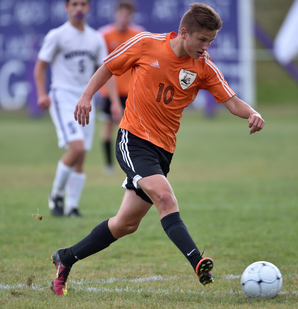 Winslow back Mike Wildes dribbles the ball down the field during a game against rival Waterville this season.
