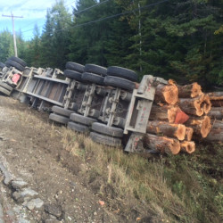 A logging truck owned by an Athens trucking company rolled over Thursday morning on U.S. Route 201 in Moose River. The driver suffered minor injuries, police said.