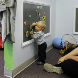 Archer White, 1, plays Thursday with his mother, Jamie, at the Children's Discovery Museum in Augusta. The museum announced it is relocating to Waterville.
