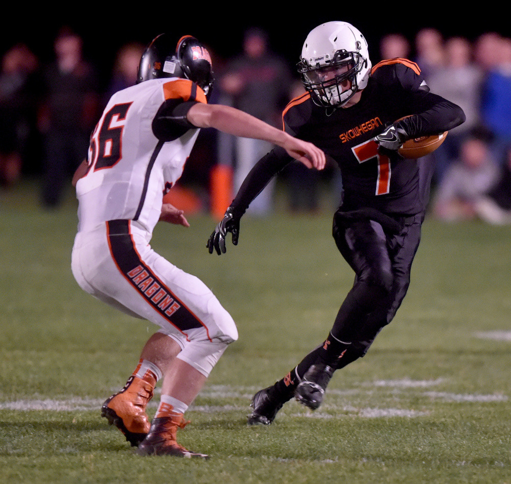 Skowhegan's John Bell (7) tries to avoid being Brunswick defender Donald Bromiley during a Pine Tree Conference Class B game Friday night in Skowhegan.