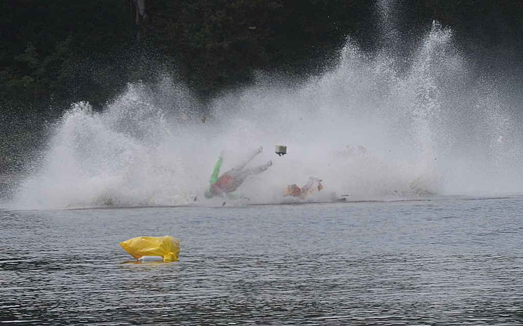 One of the racers goes airborne during a fatal crash on Saturday,  during the Bill Giles Memorial Regatta on Watson Pond in Taunton, Mass.  Mike Gay/The Daily Gazette via AP
