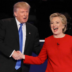 Donald Trump and Hillary Clinton shake hands after a debate in which they traded insults and accusations.
