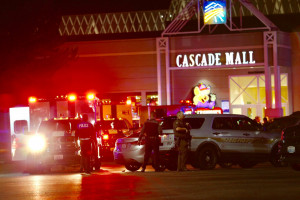 Police officers work at the crime scene outside the Cascade Mall in Burlington, Wash., where several people were fatally shot on Friday. (Dean Rutz/The Seattle Times via AP)