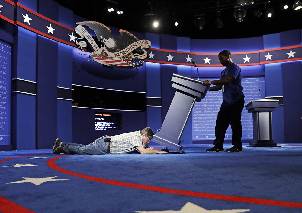 Technicians set up the stage for the presidential debate between Democratic presidential candidate Hillary Clinton and Republican presidential candidate Donald Trump at Hofstra University Sunday,<em>Patrick Semansky</em>
