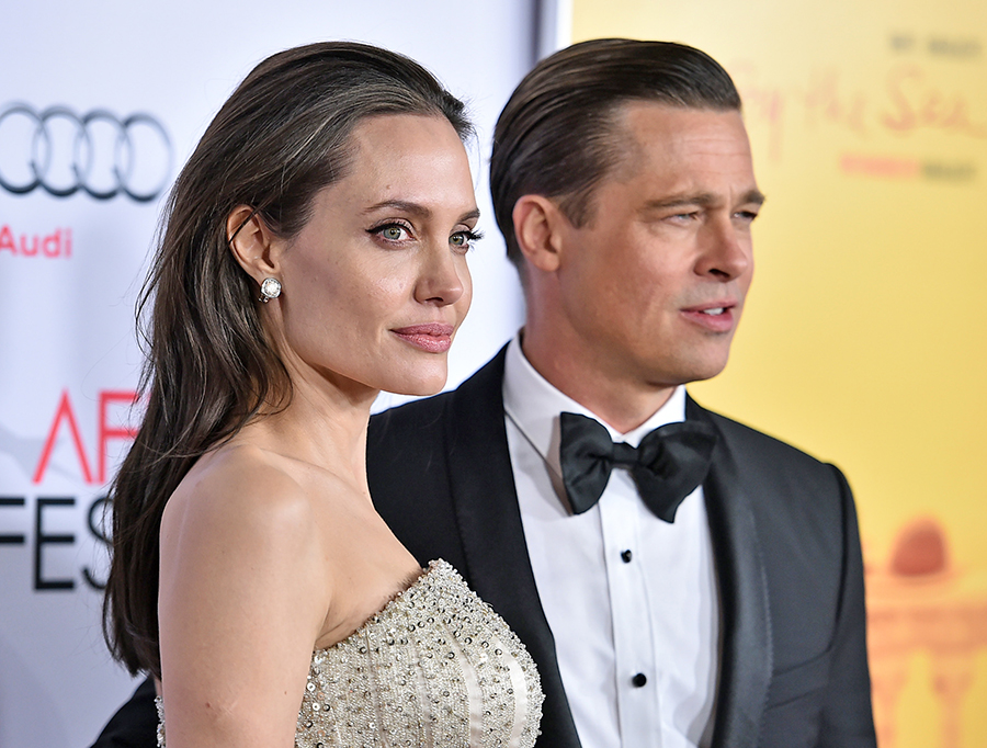 """Angelina Jolie and Brad Pitt arrive at the premiere of """"By The Sea"""" on Nov. 5, 2015, in Los Angeles."""