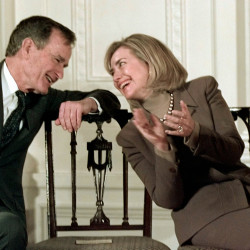 Former President George H.W. Bush and Hillary Clinton in the White House in 1997.