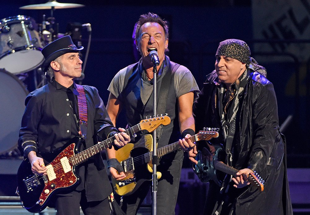 Bruce Springsteen performs with Nils Lofgren, left, and Steven Van Zandt of the E Street Band during a  March 15 concert in Los Angeles. Springsteen's 75-show U.S. and European The River Tour wraps up with a show in Foxborough, Massachusetts, on Sept. 14. <em> Chris Pizzello/Invision via AP</em>