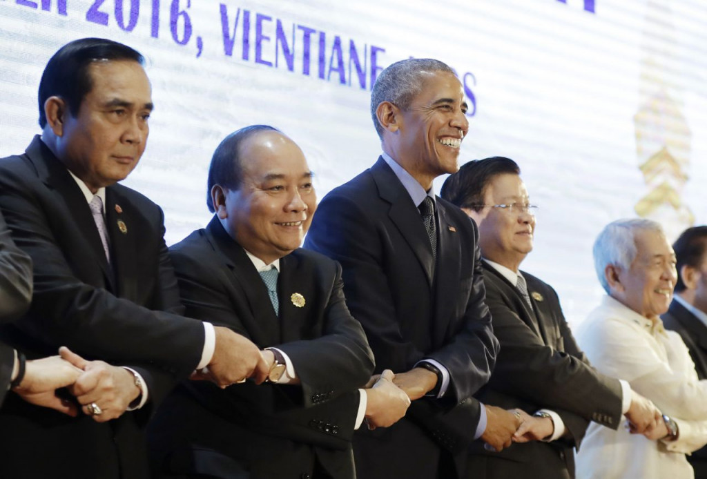 President Obama does an ASEAN-style handshake before the start of the 4th ASEAN-U.S. Summit Meeting at National Convention Center in Vientiane, Laos, Thursday. From left: Thailand's Prime Minister Prayuth Chan-ocha, Vietnam's Prime Minister Nguyen Xuan Phuc, Obama, Laos' Prime Minister Thongloun Sisoulith, and Philippines Foreign Affairs Secretary Perfecto Yasay. <em>Carolyn Kaster/Associated Press</em>