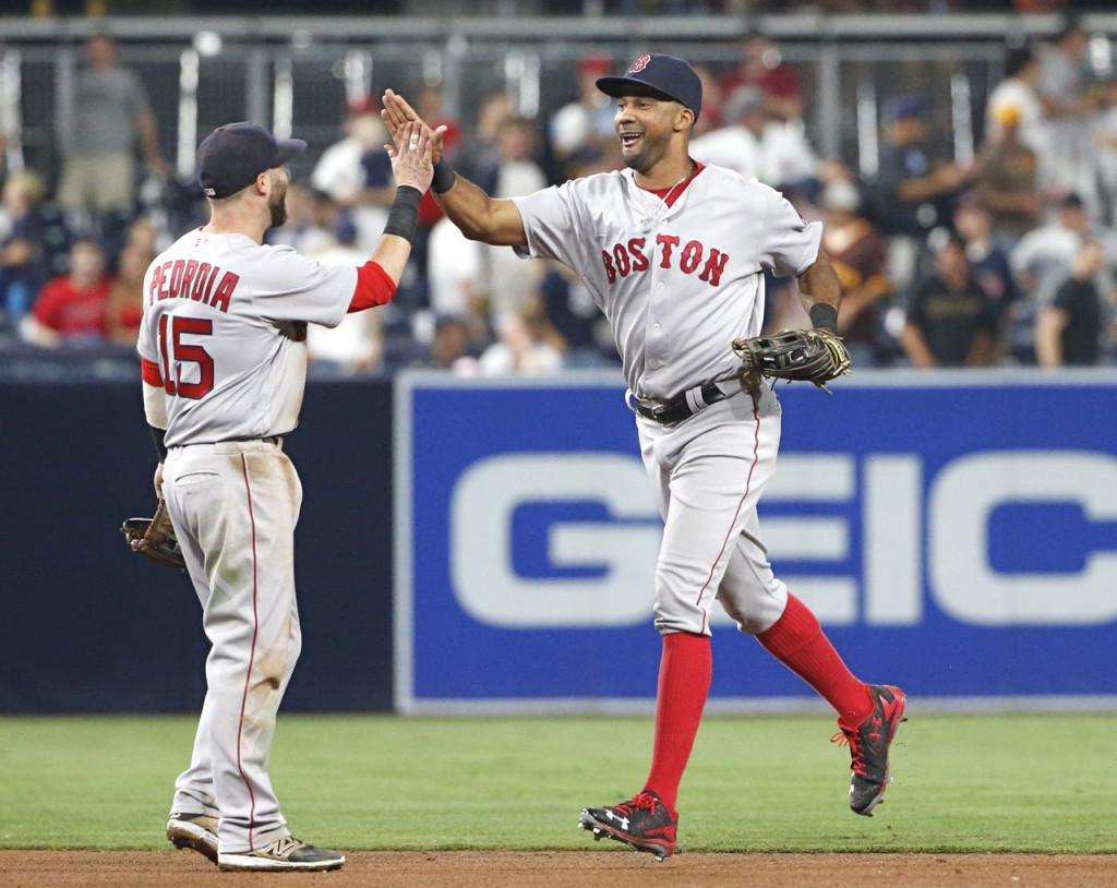 Chris Young, right, high-fives Dustin Pedroia after the Red Sox defeated the San Diego Padres 5-1 Tuesday night in San Diego. Young homered in the game. <em>Lenny Ignelzi/Associated Press</em>