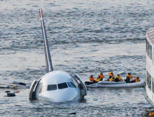 Passengers in an inflatable raft move away from the Airbus 320 US Airways aircraft that went down in the Hudson River in New York on Jan. 15, 2009. Bebeto Matthews/Associated Press