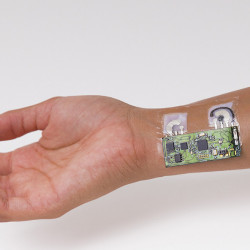 Researchers made the alcohol sensor patch from temporary-tattoo paper embedded with flexible electronics.  Photo courtesy of UC San Diego Jacobs School of Engineering