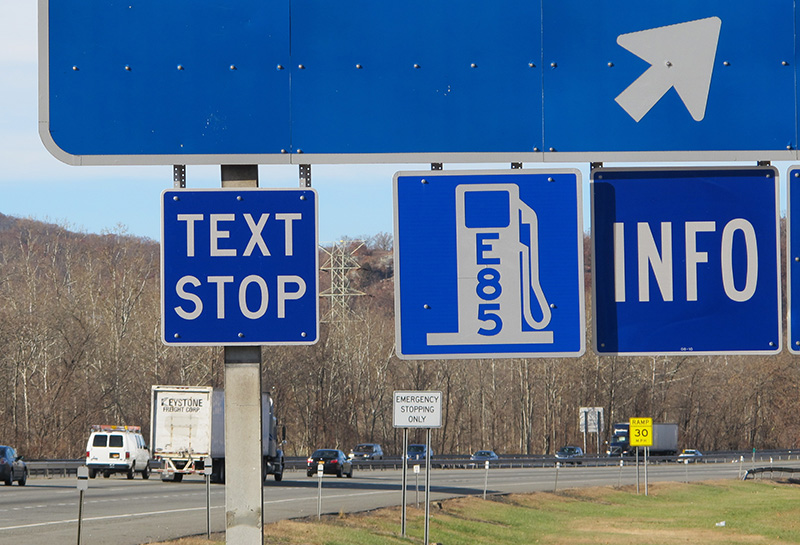 "A ""text stop"" notification on a sign for a service area on the New York State Thruway was part of a state crackdown on texting in 2013."
