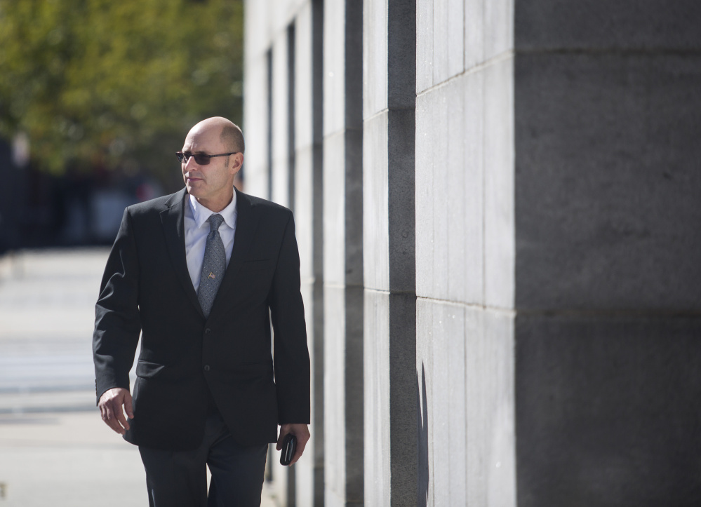 Gregory Nisbet, the Portland landlord on trial for manslaughter, walks back into the courthouse after a short recess on Tuesday Oct. 4, 2016. Nisbet's case is believed to be the first in Maine which a landlord has been accused of causing deaths that were deemed accidental because they did not do enough to ensure the safety of residents.