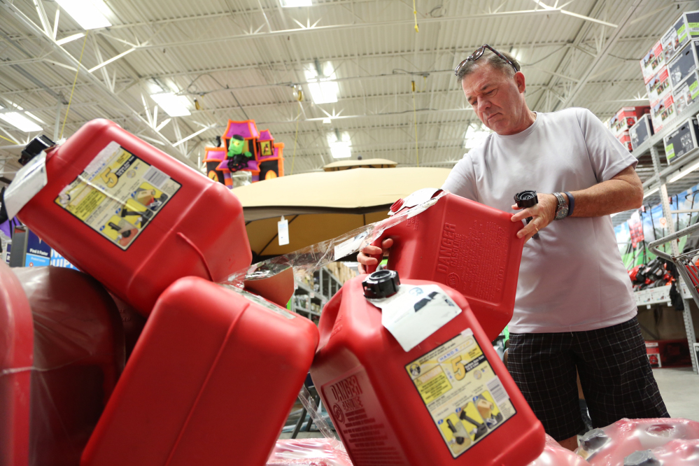 Jim LaFeir, of Ft. Lauderdale, buys a gas can at Lowe's in Oakland Park, Fla., on Tuesday. Anxious Florida residents emptied grocery store shelves and North Carolina called for the evacuation of three barrier islands as Hurricane Matthew, the most powerful Atlantic storm in a about decade, threatened to rake a large swath of the East Coast in the coming days.