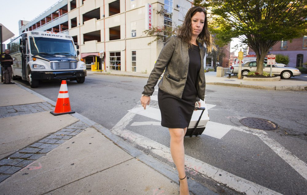 Sarah Churchill, a member of the defense team for landlord Gregory Nisbet, arrives at the Cumberland County courthouse Wednesday. The defense is arguing that Nisbet rented out the Noyes Street house as a duplex, so it didn't have to meet stricter fire safety codes that apply to rooming houses.