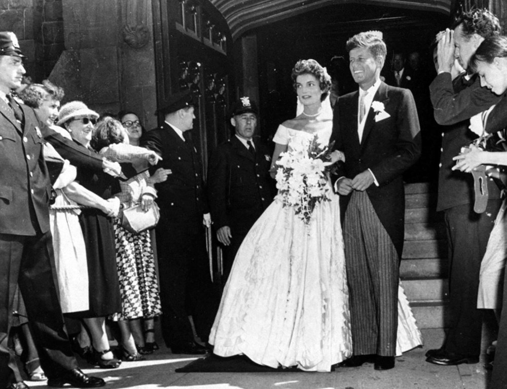 Then-Sen. John F. Kennedy, D-Mass., leaves St. Mary's Church with his bride, the former Jacqueline Bouvier, after their wedding in Newport, R.I., on Sept. 12, 1953.
