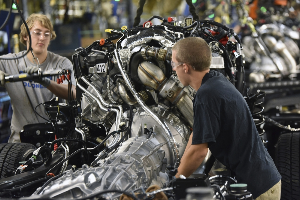 Workers assemble a 2017 Ford F-Series Super Duty truck at the Kentucky Truck Plant in Louisville, Ky. Friday's September jobs report showed the unemployment rate has remained mostly flat even as hiring has been solid.
