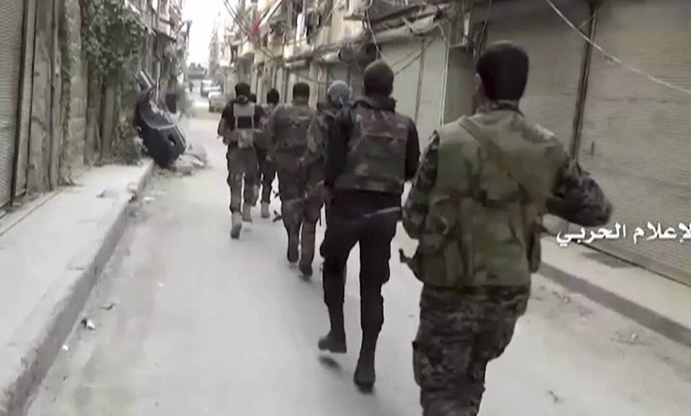 Government troops patrol Tuesday in Aleppo, Syria. A U.N. Security Council resolution calls for grounding aircraft including Russia's over the hard-hit city.