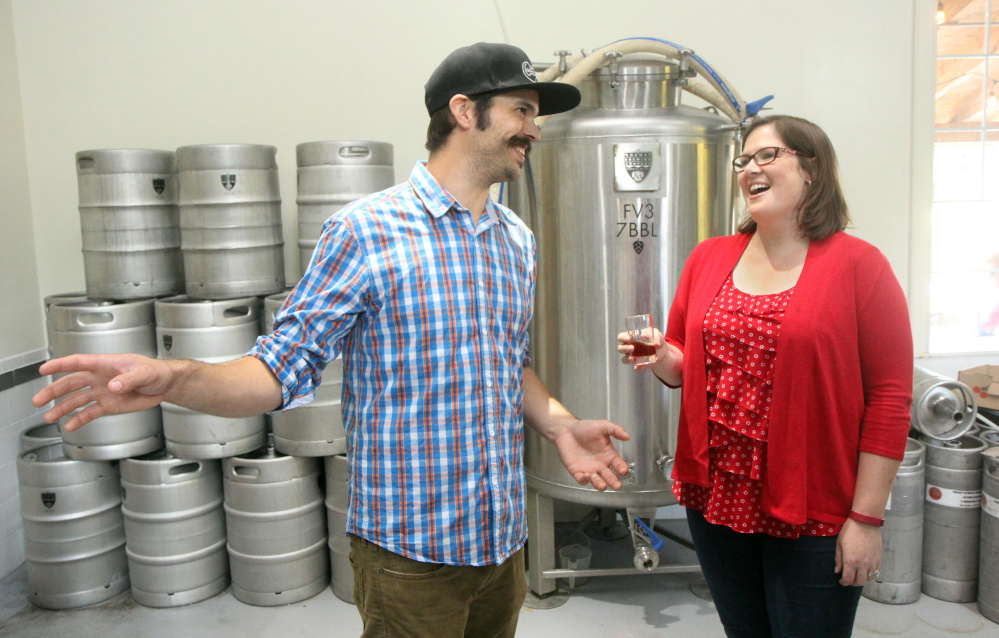 Democrat Emily Cain chats with Norway Brewing Co. co-owner Magne Melhus while campaigning Aug. 26 in Oxford County.