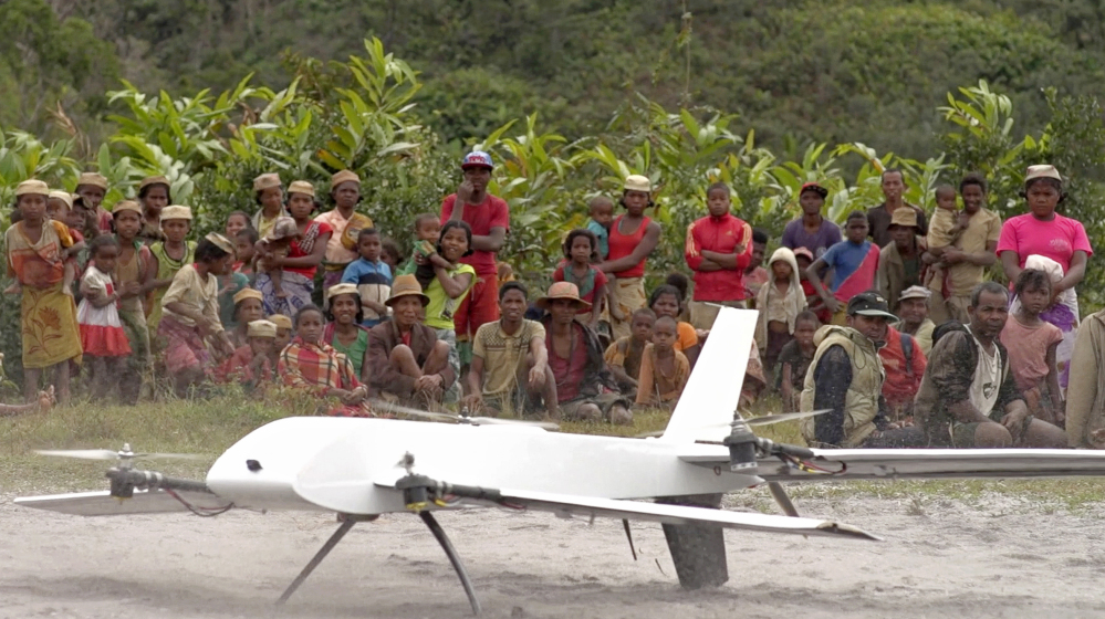 Residents of Ranomafana, Madagascar, watch before a drone containing medical samples takes off on a test flight from their remote village, which can only be reached on foot. Deliveries that would have taken weeks on land can take hours by drone.