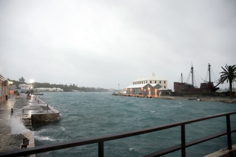 Wind brought by Hurricane Nicole makes water break over the dock on Ordnance Island in St. Georges, Bermuda, on Thursday.