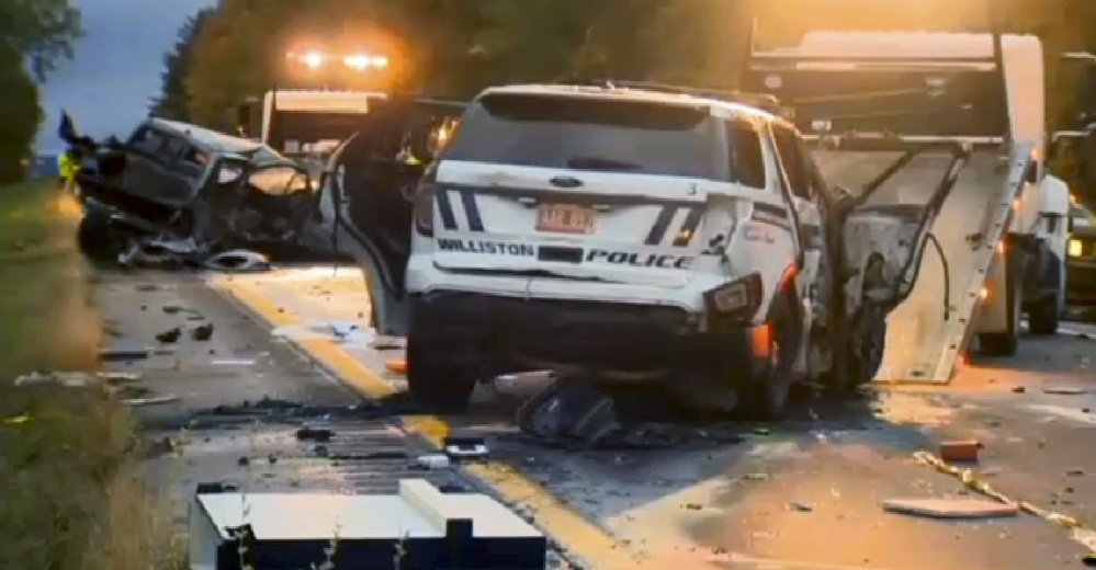 Workers remove vehicles from Interstate 89 early Sunday in Williston, Vt., after a wrong-way driver caused a crash just before midnight that killed five teenagers.