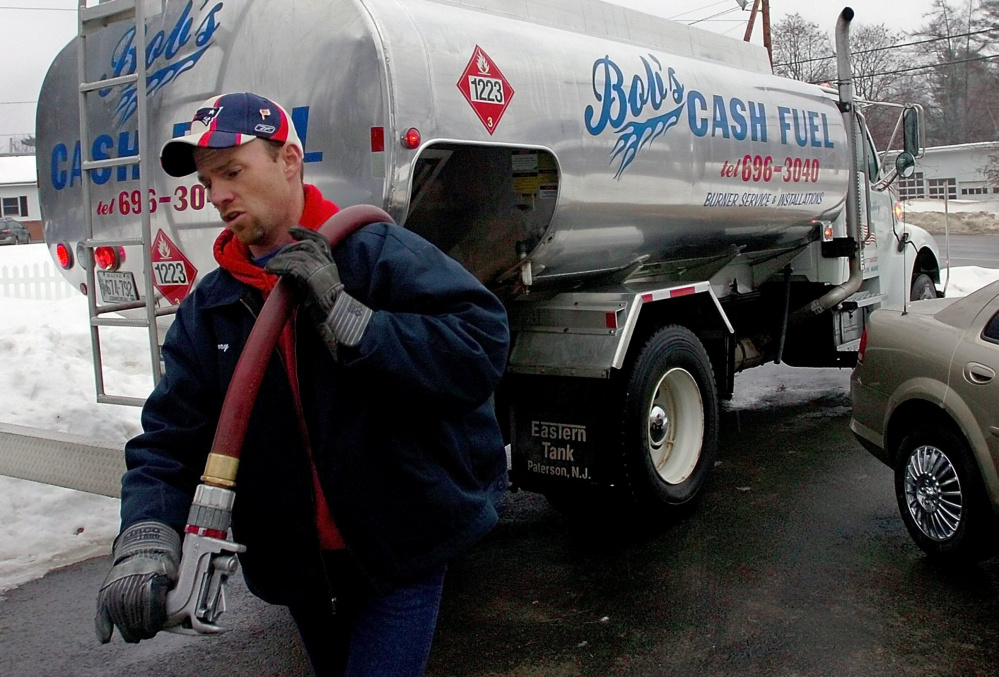 Jerry Prescott of Bob's Cash Fuel in Madison prepares to fill a tank with heating oil last winter.