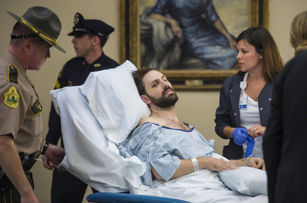 Steven Bourgoin is arraigned in a makeshift courtroom at the University of Vermont Medical Center on five counts of second-degree murder in Burlington, Vt., on Friday. He pleaded not guilty of driving the wrong way on an interstate and causing a fiery crash that killed five teenagers and critically injured himself.