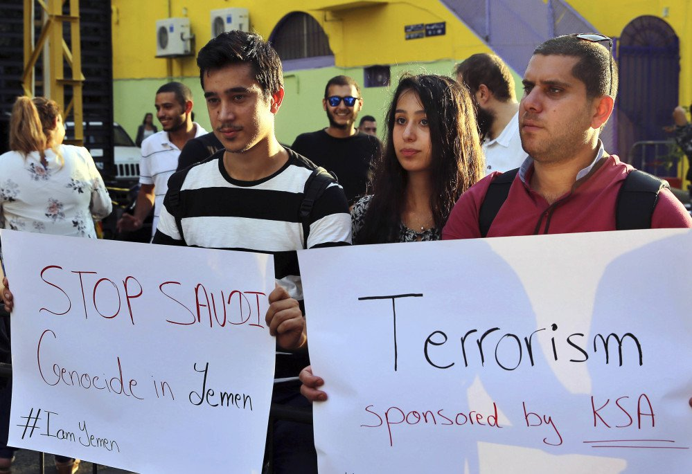 Activists hold placards during a protest to show their solidarity with Yemen's Shiite rebels, known as Houthis, in front of the  Saudi embassy, in Beirut, Lebanon, on Tuesday.