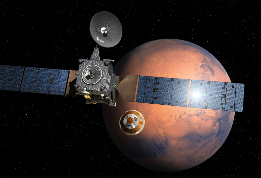 An artist's impression depicts the separation of the European Space Agency probe named Schiaparelli, center, from the Trace Gas Orbiter, left, to descend to Mars. Schiaparelli is set to enter the atmosphere of Mars on Wednesday at a speed of nearly 13,000 mph.