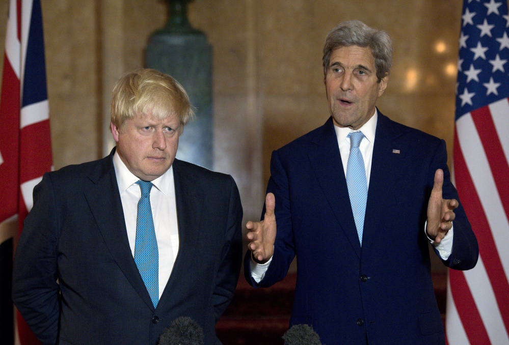 U.S. Secretary of State John Kerry, right, and British Foreign Secretary Boris Johnson discuss Syria at a news conference. in London.
