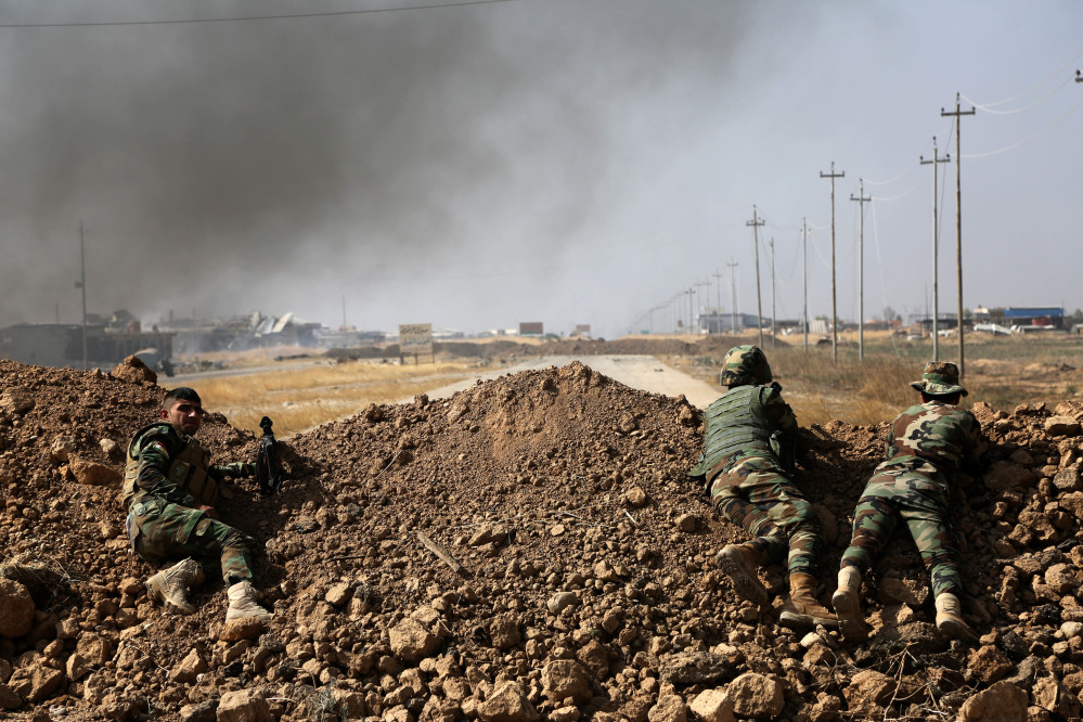 Kurdish security forces take up a position as they fight overlooking the Islamic State-controlled villages surrounding Mosul, in Khazer, about 30 kilometers (19 miles) east of Mosul, Iraq.