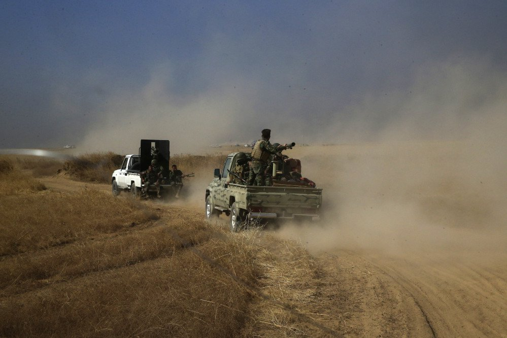 A Peshmerga convoy drives toward a frontline in Khazer, about 19 miles east of Mosul, Iraq, Monday.