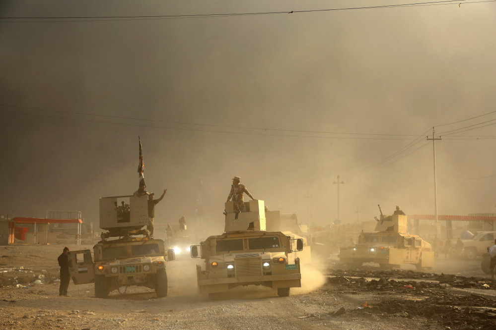 An Iraqi military convoy advances towards the city of Mosul, Iraq, on Wednesday.