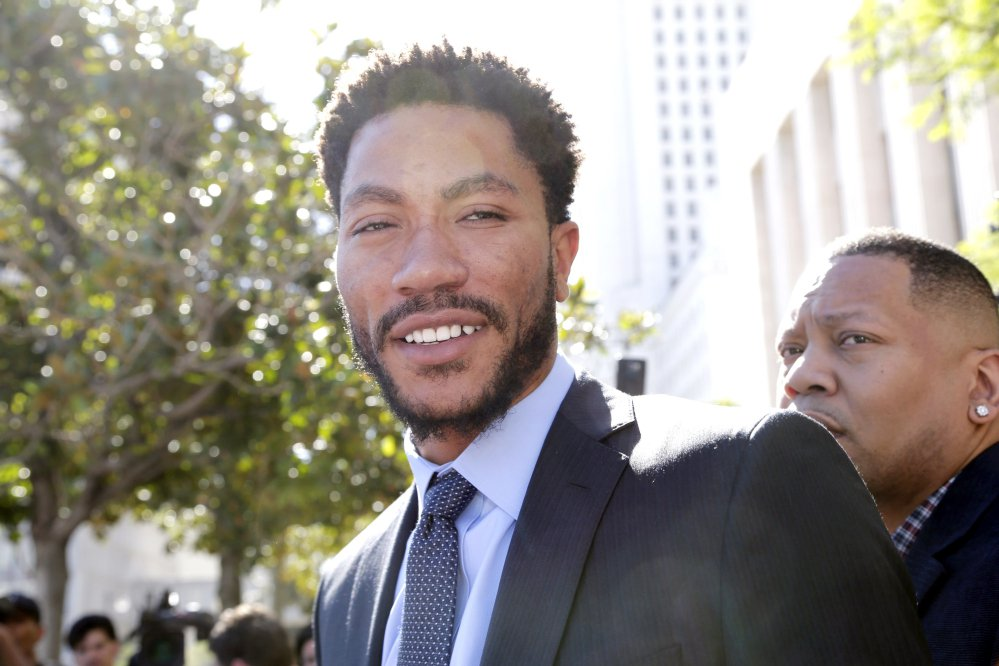 NBA star Derrick Rose leaves federal court in Los Angeles on Wednesday after jurors cleared him and two friends in a lawsuit that accused them of gang raping his ex-girlfriend when she was incapacitated from drugs or alcohol.