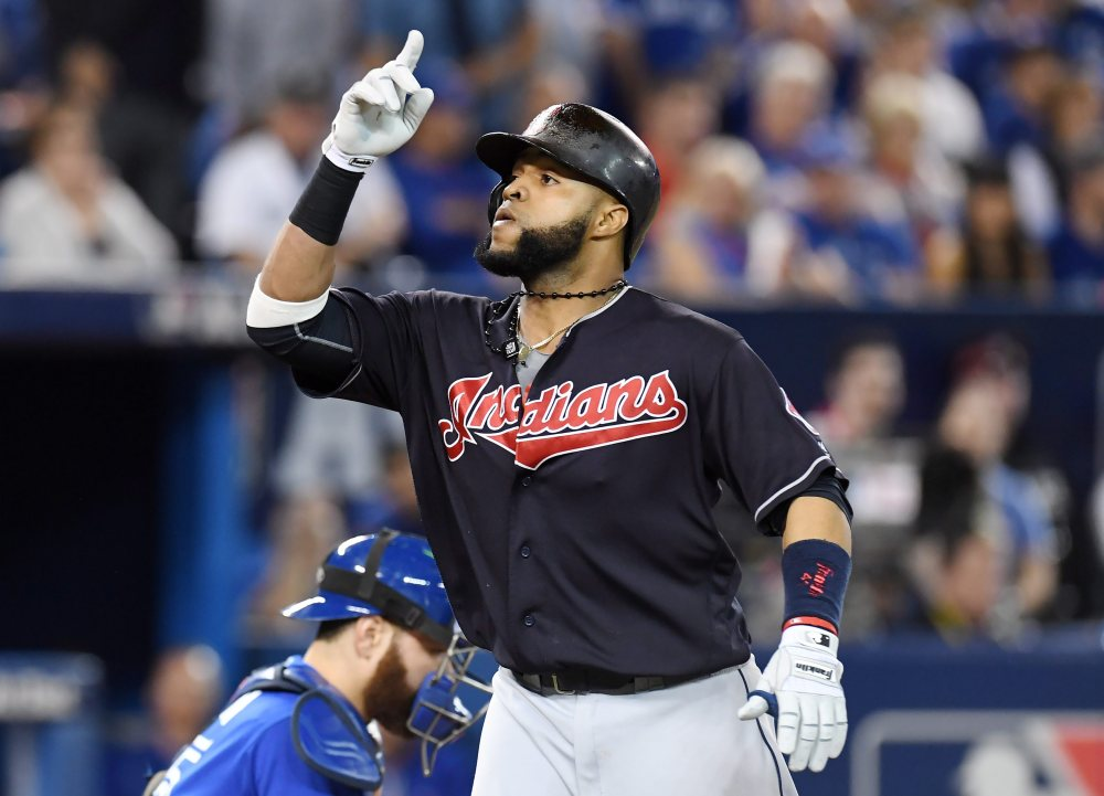 Carlos Santana gestures after hitting a home run against the Blue Jays in the third inning in Game 5 of baseball's American League Championship Series in Toronto on Wednesday.