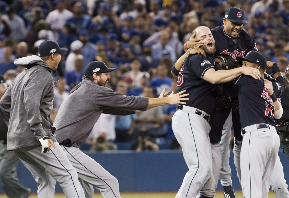 The Cleveland Indians celebrate after defeating the Toronto Blue Jays 3-0 in Game 5 of the baseball American League Championship Series in Toronto on Wednesday.