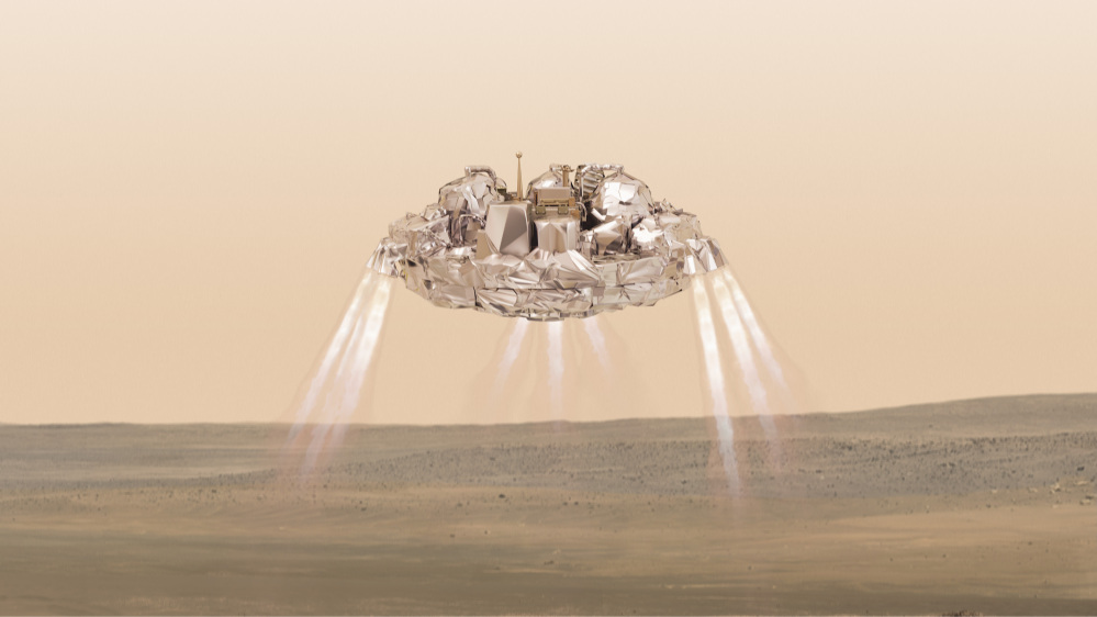 This artist impression  provided by the European Space Agency, ESA, shows the  Schiaparelli module with thrusters firing. On Wednesday Oct. 19, 2016  Schiaparelli will enter the martian atmosphere at an altitude of about 121 km and a speed of nearly 21 000 km/h. Less than six minutes later it will have landed on Mars. The probe will take images of Mars and conduct scientific measurements on the surface, but its main purpose is to test technology for a future European Mars rover.  Schiaparelli's mother ship ,TGO, will remain in orbit to analyze gases in the Martian atmosphere to help answer whether there is or was life on Mars. (ESA/ATG-medialab via AP)