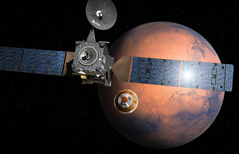An artist's impression depicts the Schiaparelli, center, as it separates from the mother ship and heads for Mars. NASA has placed several robotic vehicles on the planet.