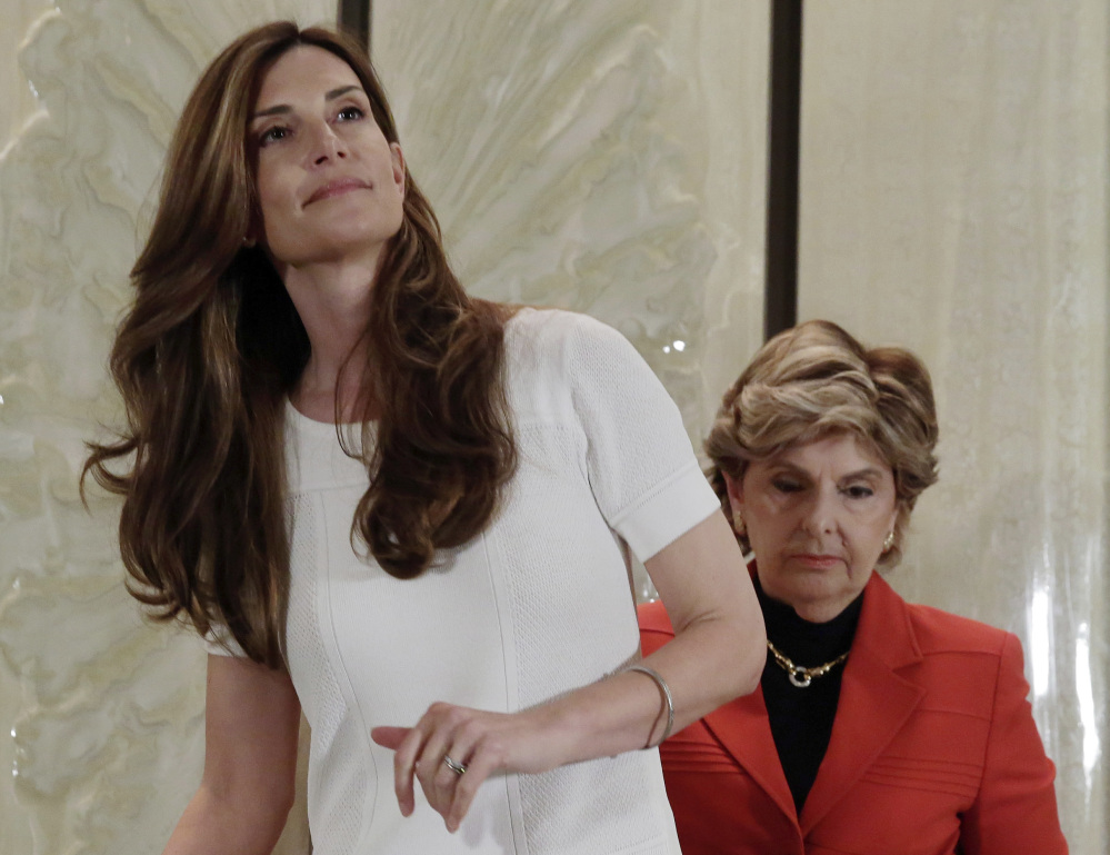 Karena Virginia, left, with lawyer Gloria Allred, arrives for a news conference Thursday in New York, where she accused Donald Trump of inappropriate sexual conduct.