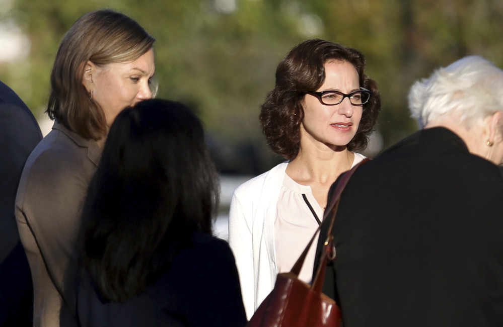 Sabrina Erdely, center, enters the federal courthouse in Charlottesville, Va., on Monday. Erdely wrote a discredited Rolling Stone article detailing an alleged rape at UVA.