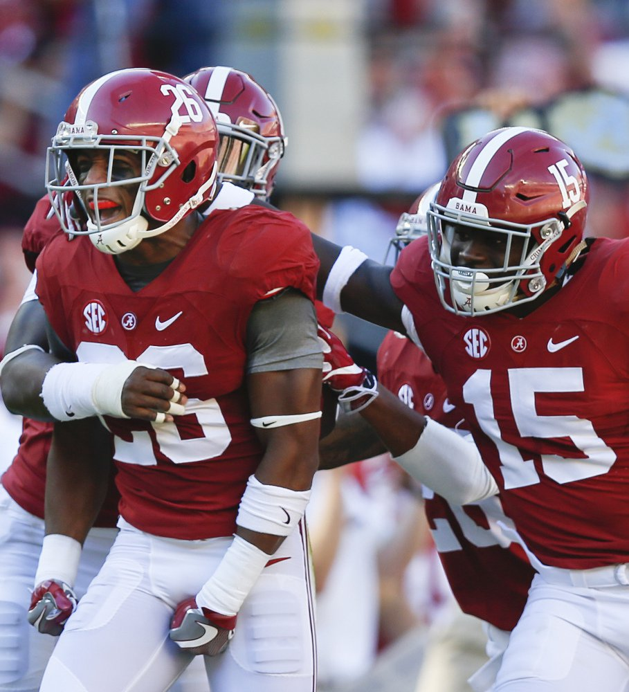 Alabama defensive back Marlon Humphrey, left, celebrates with Ronnie Harrison, right, and other teammates after an interception in the first half on Saturday during a 33-14 win over No. 6 Texas A&M.
