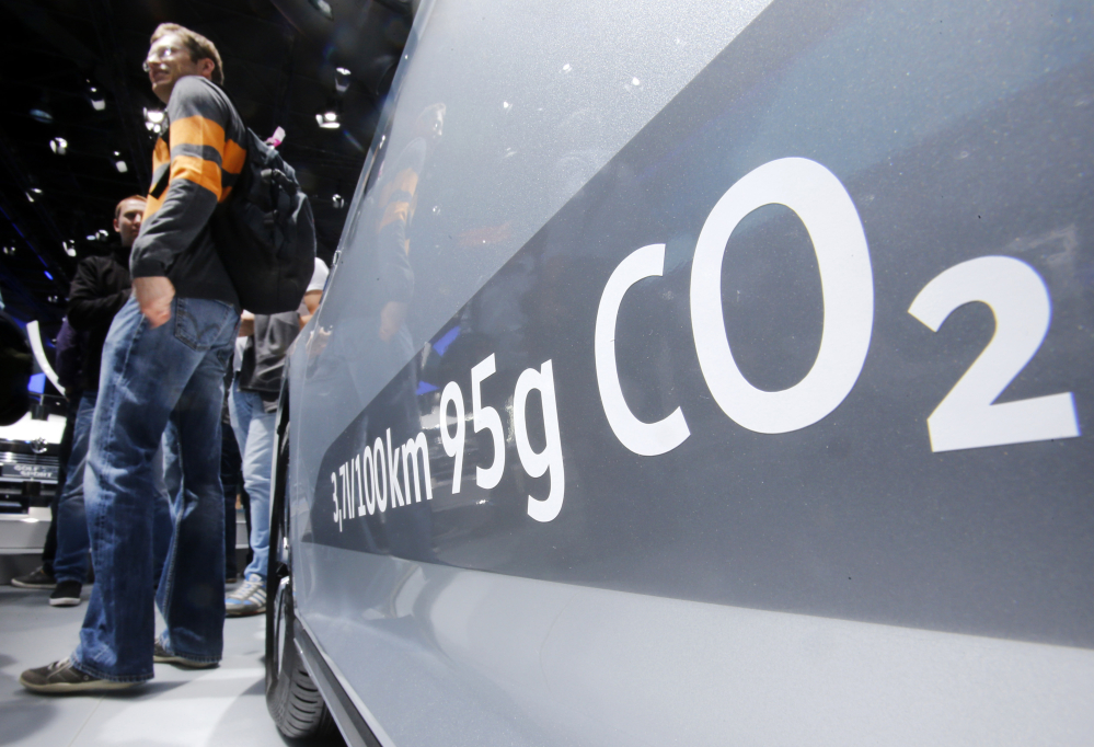 A Volkswagen Passat in Frankfurt, Germany, shows the amount of carbon dioxide the vehicle emits. Tuesday's court decision in the company's emissions-cheating scandal involves nearly 475,000 drivers.