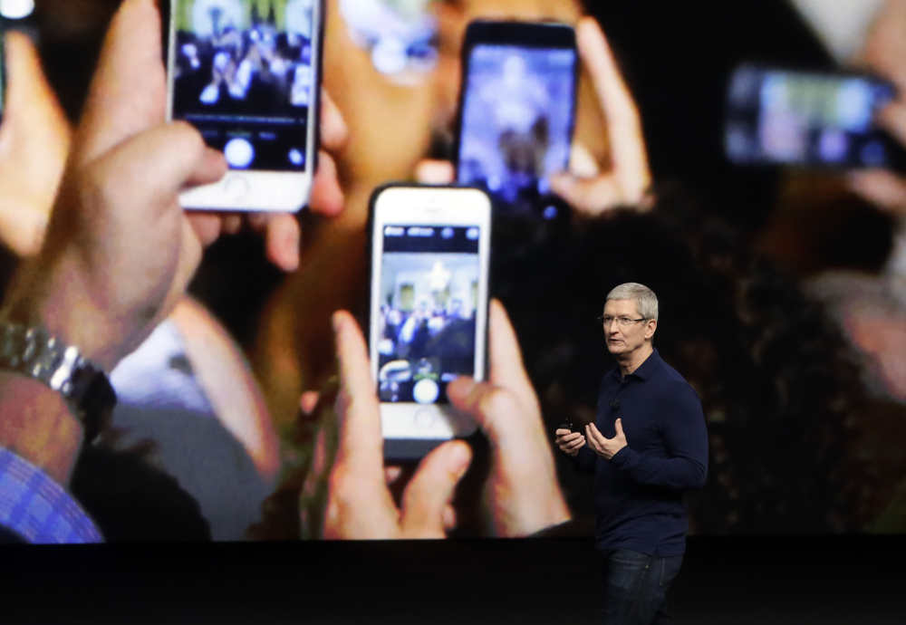 This October 2016 file photo shows Apple CEO Tim Cook, who emphasized growth in the company's services section as Apple reported that it sold 45.5 million iPhones in the previous quarter, 5 percent fewer than it sold a year earlier, in 2015.