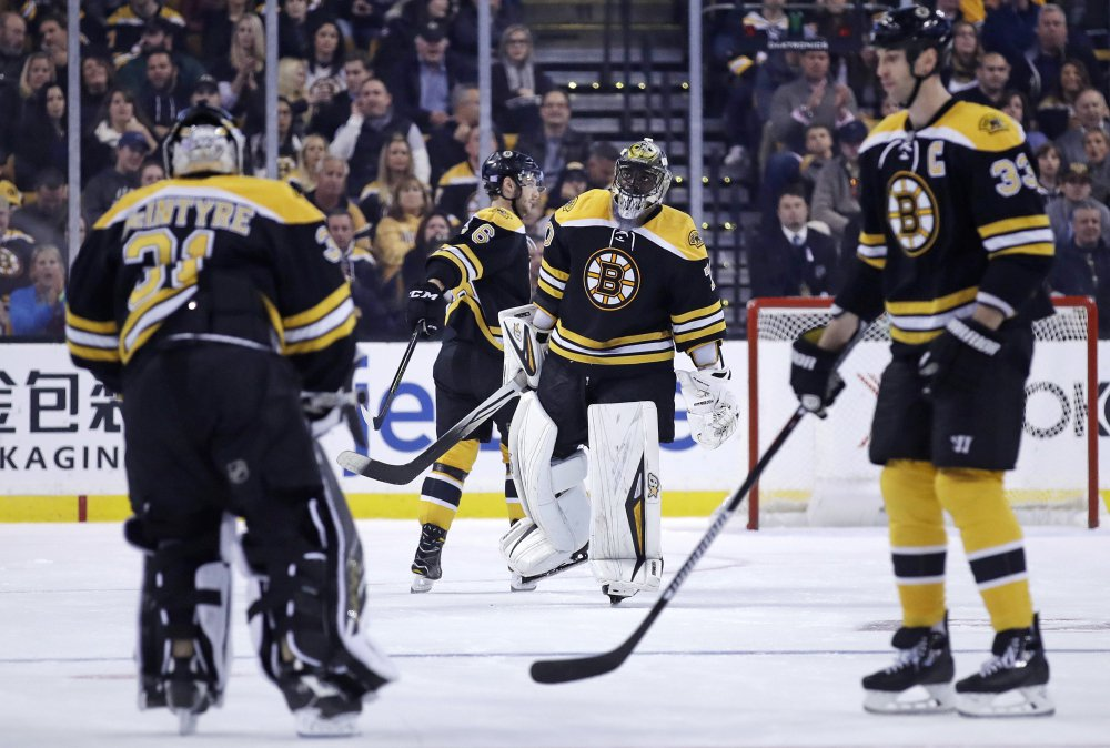 Bruins goalie Malcolm Subban, center, is replaced by goalie Zane McIntryre (31) in the second period after allowing his third goal of the game.