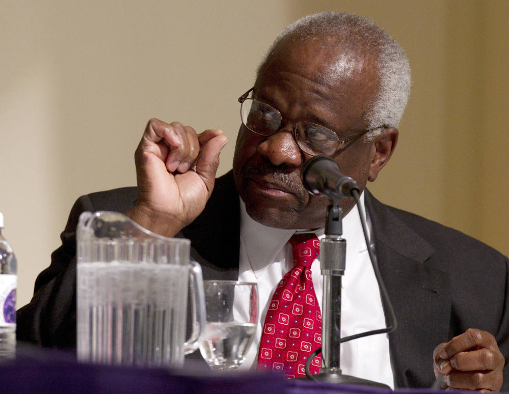 """Supreme Court Justice Clarence Thomas says a claim that he groped a young woman at a Washington dinner party in 1999 """"is preposterous."""""""