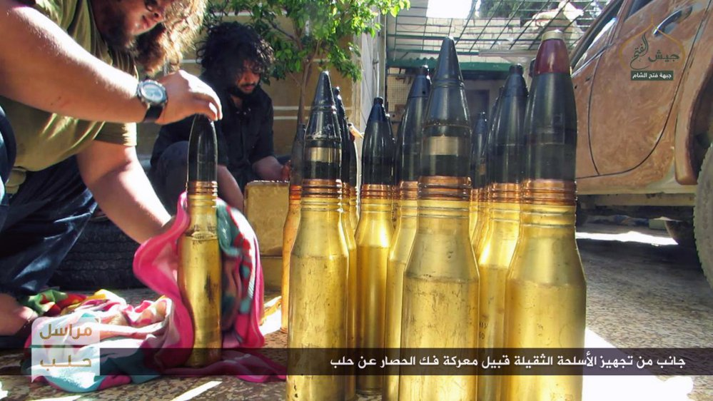 Photo released online Friday by the al-Qaida-linked Fatah al-Sham shows fighters preparing shells in the northern Syrian province of Aleppo.